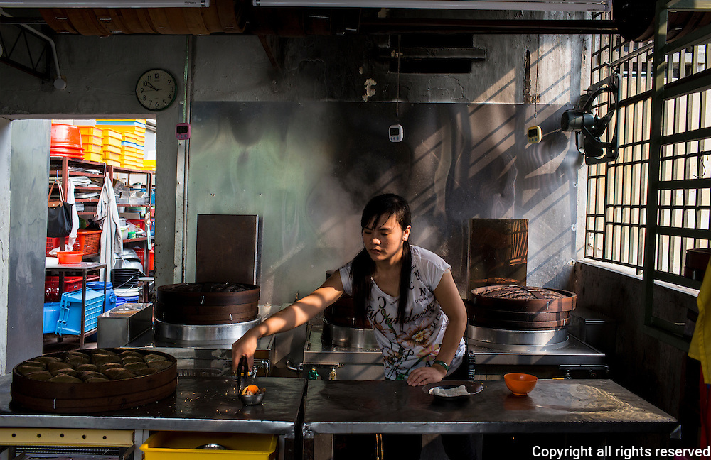 a foreign worker prepares dim sum in a Chinese owned restaurants. Penang has banned foreigners from cooking 'local' foods. george town, Penang, Malaysia