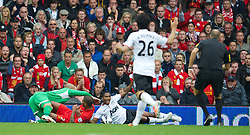 LIVERPOOL, ENGLAND - Sunday, September 23, 2012: Manchester United's Antonio Valencia falls over in the penalty area under a challenge from Liverpool's Glen Johnson, and a penalty is awarded, during the Premiership match at Anfield. (Pic by David Rawcliffe/Propaganda)