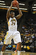 November 29, 2011: Iowa Hawkeyes guard Bryce Cartwright (24) drives with the ball during the first half of the NCAA basketball game between the Clemson Tigers and the Iowa Hawkeyes at Carver-Hawkeye Arena in Iowa City, Iowa on Tuesday, November 29, 2011. Clemson defeated Iowa 71-55 in the Big Ten-ACC Challenge game.