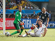 Mats Hummels of Germany (white) steers a cross clear from Karim Benzema of France (R) and Manuel Neuer of Germany (L) in the 1st half during the 2014 FIFA World Cup match between France and Germany at the Maracana Stadium, Rio de Janeiro<br /> Picture by Andrew Tobin/Focus Images Ltd +44 7710 761829<br /> 04/07/2014