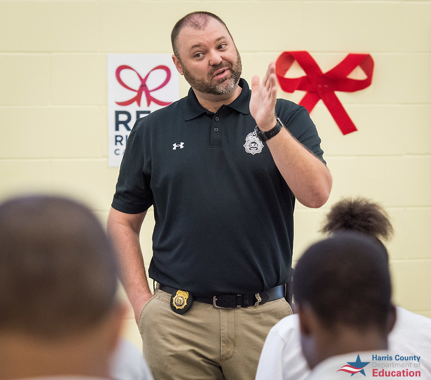 Drug Enforcement Administration Special Agent  Donald Hurst talks with students at Highpoint East, October 25, 2017.