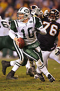 SAN DIEGO, CA - JANUARY 8:  Quarterback Chad Pennington #10 of the New York Jets runs for daylight while completing 23 of 33 passes for 279 yards and 2 touchdowns against the San Diego Chargers at Qualcomm Stadium on January 8, 2005 in San Diego, California. The Jets defeated the Chargers 20-17 in overtime in the AFC Wild Card Game. ©Paul Anthony Spinelli  *** Local Caption *** Chad Pennington