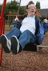 Man with learning disability on swing