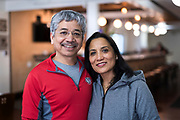 Owners Deepak and Archana Shrestha pose for a portrait inside the Hungry Badger Cafe in Madison, WI on Sunday, April 14, 2019.