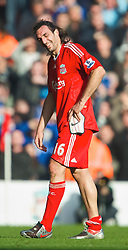 LIVERPOOL, ENGLAND - Saturday, February 6, 2010: Liverpool's Sotirios Kyrgiakos walks off the field after being sent off during the Premiership match against Everton at Anfield. The 213th Merseyside Derby. (Photo by: David Rawcliffe/Propaganda)