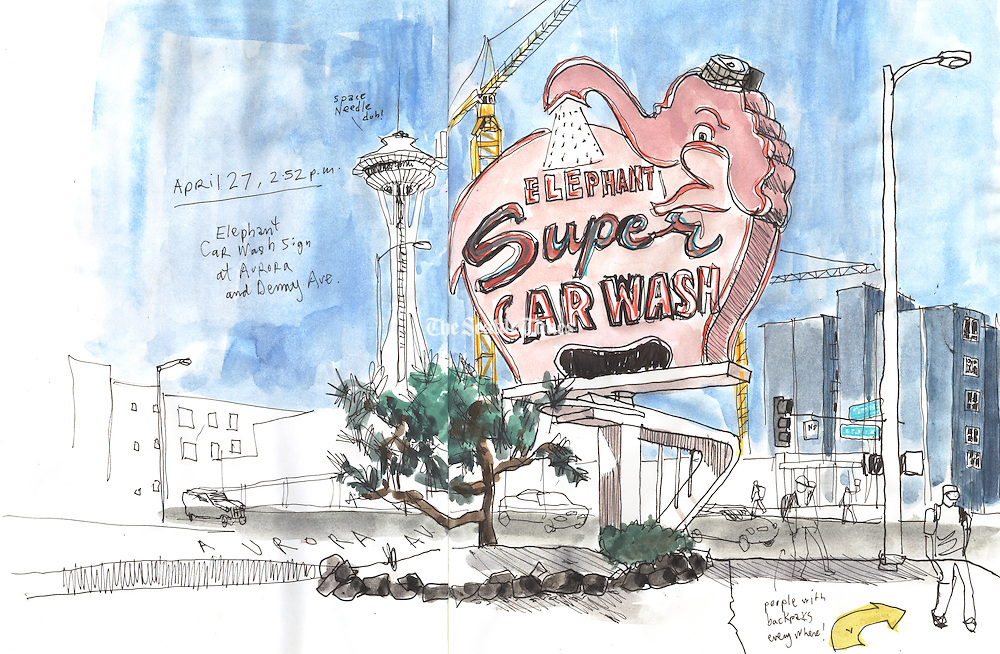 The Elephant Car Wash sign on Battery Street, this location opened in 1956.<br />
