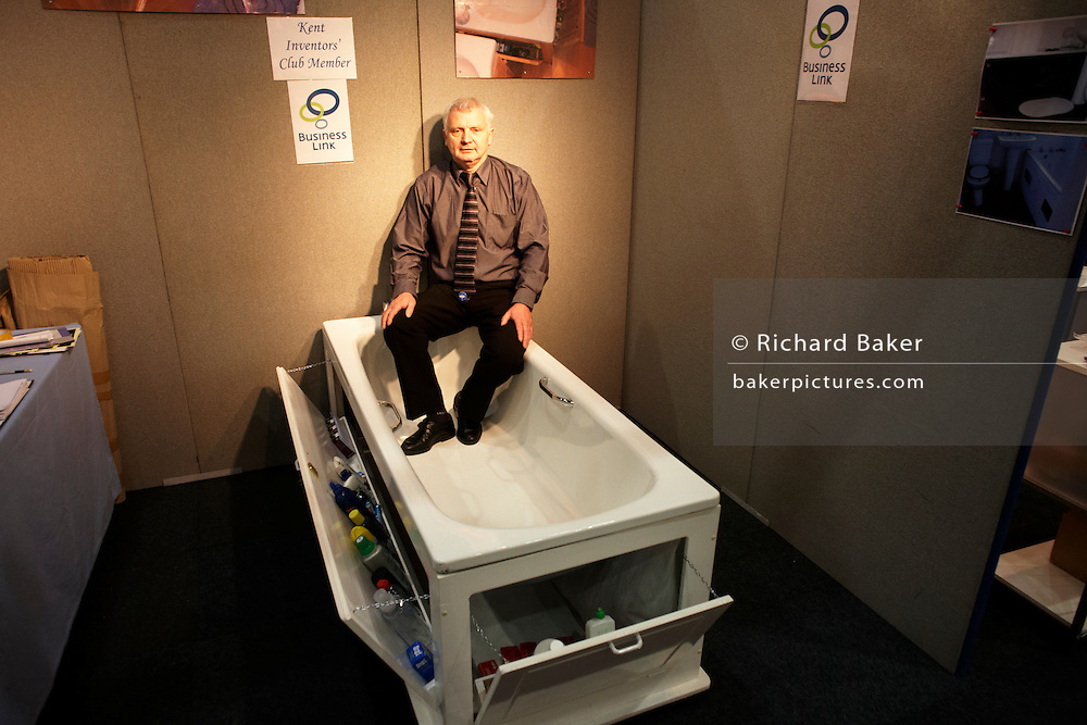 A new bathroom stowage concept is demonstrated by an entrepreneur at an inventors fair in Alexandra Palace, London