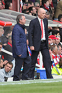 Picture by David Horn/Focus Images Ltd +44 7545 970036.27/04/2013.Uwe Rosler , Manager of Brentford (right) and Brian Flynn , Manager of Doncaster Rovers (left) during the npower League 1 match at Griffin Park, London.