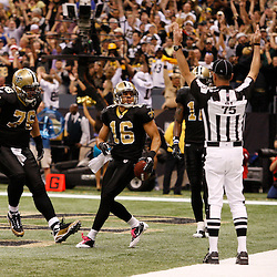 Oct 31, 2010; New Orleans, LA, USA; New Orleans Saints wide receiver Lance Moore (16) celebrates a touchdown during the second half against the Pittsburgh Steelers at the Louisiana Superdome. The Saints defeated the Steelers 20-10.  Mandatory Credit: Derick E. Hingle..