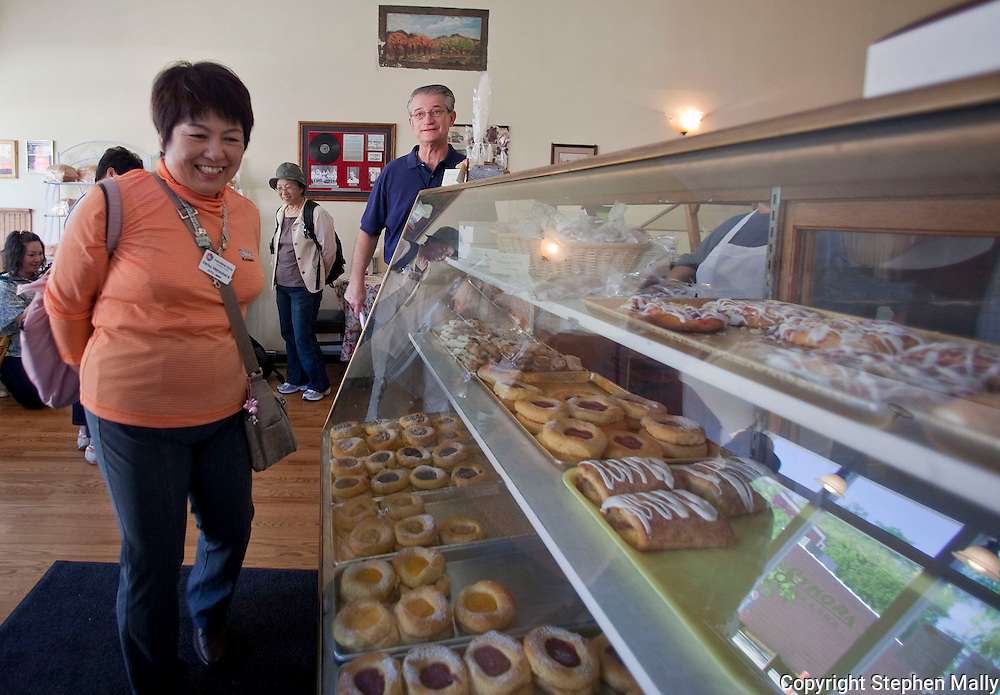 Keiko Matsubara of Gifu, Japan looks at the various kolache options during a stop by Friendship Force at Sykora Bakery in Cedar Rapids on Wednesday, June 16, 2010. Twenty people from Gifu, Japan are on the Friendship Force trip to Iowa.