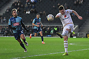 Milton Keynes Dons defender Jordan Moore-Taylor (15) clears under pressure from Wycombe Wanderers midfielder Alex Pattison (8) during the EFL Sky Bet League 1 match between Milton Keynes Dons and Wycombe Wanderers at stadium:mk, Milton Keynes, England on 1 February 2020.