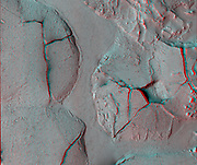 This stereo view shows fractured mounds on the southern edge of Elysium Planitia on Mars. Mars Reconnaissance Orbiter.