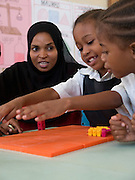 Teacher Asya Hassan Mussa is teaching a class full of primary school children at Saateni nursery school, Zanzibar, Tanzania.. Teacher Asya wast aught by VSO volunteer teacher trainer, Daphne Sharp, who has now trained over 100 nusery school teachers and 18 heads of pre school.