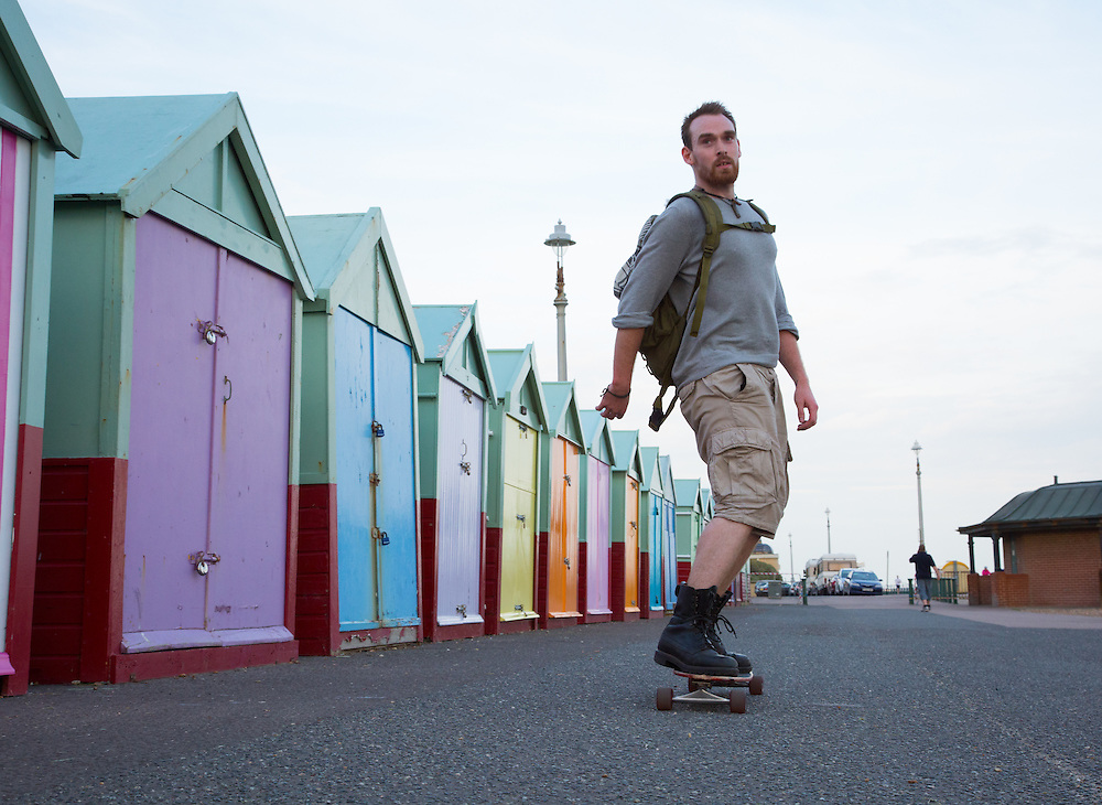"Alex commutes two miles to work in the summer on a longboard. ""It's nice to be active and in the elements, rather than squashed in a bus. It's also soothing for the soul,"" he adds. I need no convincing, as I watch his frame rapidly disappearing past the iconic Hove beach huts."