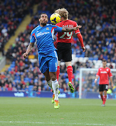 Hull City's Tom Huddlestone wins a high ball over Cardiff City's Mats Moller Daehli - Photo mandatory by-line: Alex James/JMP - Tel: Mobile: 07966 386802 22/02/2014 - SPORT - FOOTBALL - Cardiff - Cardiff City Stadium - Cardiff City v Hull City - Barclays Premier League