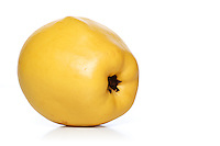 Close-up of quince on white background