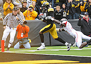 October 03, 2009: Iowa wide receiver Marvin McNutt (7) pulls in a 41 yard touchdown reception in front of Arkansas State defensive back Kelcie McCray (21) during the first half of the Iowa Hawkeyes' 24-21 win over the Arkansas State Red Wolves at Kinnick Stadium in Iowa City, Iowa on October 03, 2009.