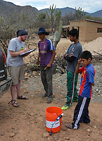 Demonstrating the Sawyer water filter in Moro Moro, Santa Cruz, Bolivia