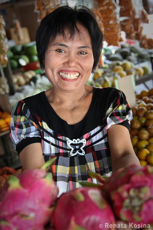 A market vendor on the island of Langkawi, Malaysia offers produce from her store.