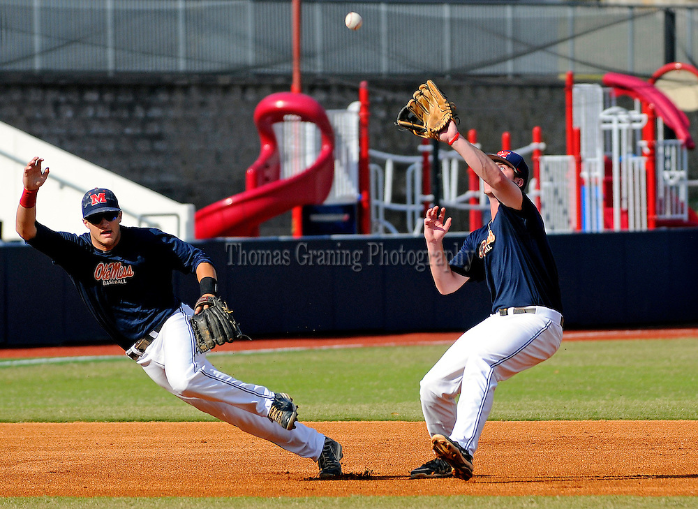 Mississippi blue team's Austin Anderson (8), right, and Christian Helsel (34) field the ball during a baseball game in Oxford, Miss., Wednesday, Oct. 24, 2012. (Photo/Thomas Graning)