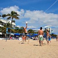 Beach Volleyball in Fort Lauderdale, Florida<br /> Beach volleyball is an amazing sport to watch as an Olympic event or among talented, professional athletes.  At the other end of the spectrum is the version played by college students during spring break. When they are lucky enough to serve the ball over the net, the volley rarely lasts more than one or two times.  Occasionally you see someone like this young man who is competitive enough to jump high and then spike the ball.