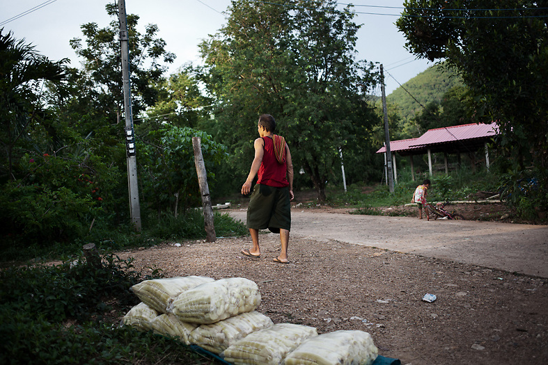 A father and his child in Pak Ok village, where the first case of surrogate motherhood was recorded. The village main activity is to pick, peal and boil bamboo shoots to sell them.<br /> Lom Sak, Petchabun province, Thailand. Aug 24 2014<br /> Credit : Giorgio Taraschi for The New York Times