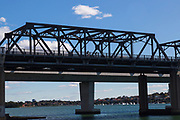Cyclists pass along the  Iron Cove Bridge, Sydney, Australia,
