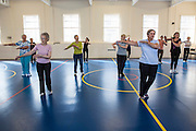 One of the exercise classes for the elderly run by Jillian Furness in the Percy community centre, Bath. With the help and support of Bath and West Community Energy they have a solar PV array on their roof and have installed energy efficient (LED) lightbulbs throughout their centre. Bath, Somerset.