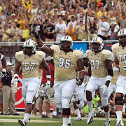 The UCF Knights enter the field prior to an NCAA football game between the South Carolina Gamecocks and the Central Florida Knights at Bright House Networks Stadium on Saturday, September 28, 2013 in Orlando, Florida. (AP Photo/Alex Menendez)