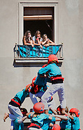 Girls looking Castellers de Vilafranca.'Castellers' building human tower, a Catalan tradition. Vilafranca del Penedès. Barcelona province, Spain