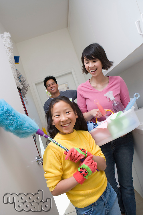 Family with girl (10-12) doing housework