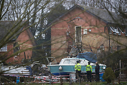 © Licensed to London News Pictures. 15/02/2017. Oxford, UK. Police stand near the scene of a block of flats damaged in an explosion near Osney Lock in Oxford. A number of people have been injured in what is thought to have been a gas explosion. Photo credit: Peter Macdiarmid/LNP