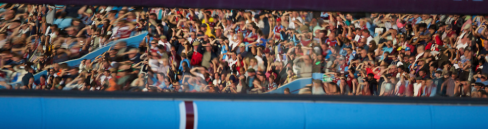 LIVERPOOL, ENGLAND - Saturday, August 24, 2013: Fans reflected in the windows of the executive boxes during the Premiership match at Villa Park. (Pic by David Rawcliffe/Propaganda)