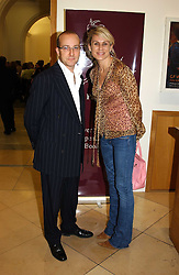 PAUL McKENNA and MISS CLARE STAPLES at a party to celebrate the publication of 'You Are Here' by Rory Bremner, Juhn Bird and John Fortune held at the National Portrait Gallery, St.Martin's Place, London on 1st November 2004.<br />