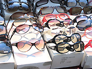 Sunglasses for sale at a street vendor's table in New York City