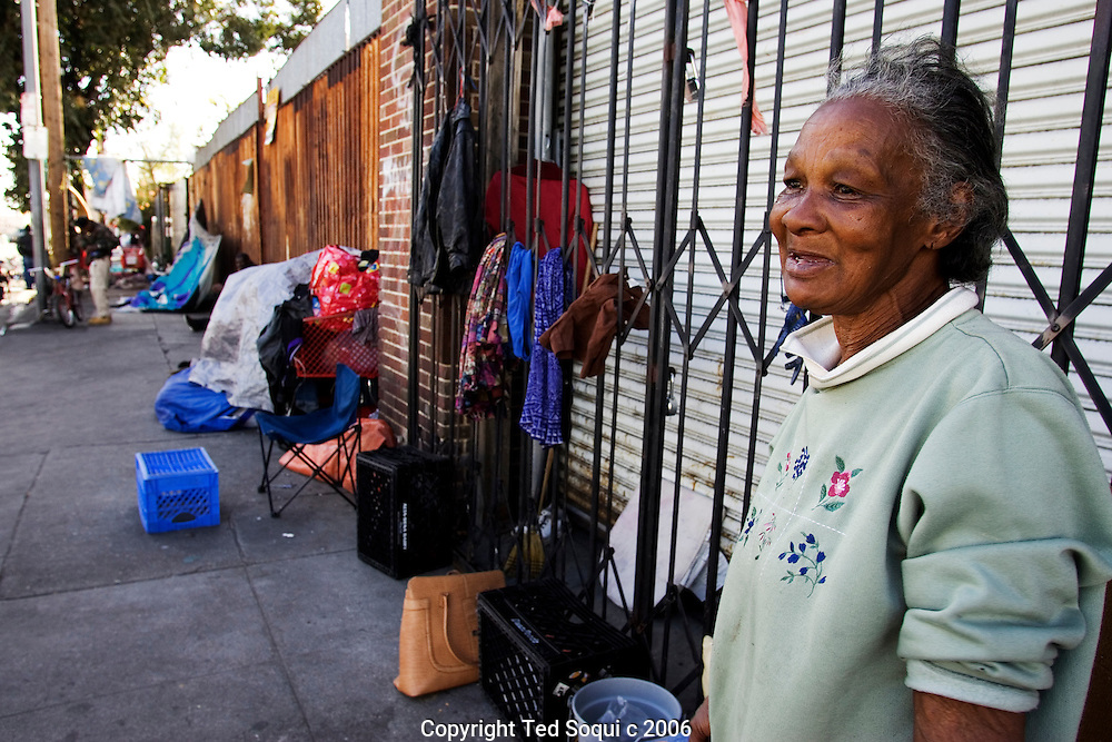 An elderly homeless women standing on in front of her makeshift encampment on Los Angeles's skid row