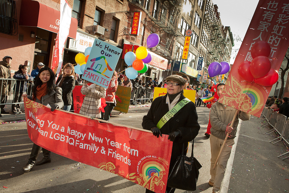 Families and friends of the Asian LGBTQ community in the parade.