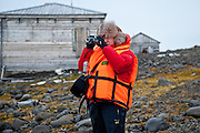 A Russian tourist takes video at Sedov Point, an abandoned polar station in Franz Josef Land, Russian Arctic.