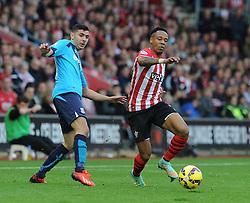 Southampton's Nathaniel Clyne passes Stoke's Oussama Assaidi - Photo mandatory by-line: Dougie Allward/JMP - Mobile: 07966 386802 - 25/10/2014 - SPORT - Football - Southampton - ST Mary's Stadium - Southampton v Stoke - Barclays Premier League