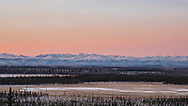 Alpenglow at sunrise over Tetlin National Wildlife Refuge and Mentasta Mouintains in Interior Alaska. Winter.
