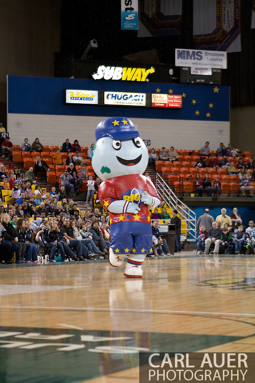 """April 30th, 2010 - Anchorage, Alaska:  Inflatable Globetrotter mascot """"Big G"""" entertains the crowd at the Sullivan Arena."""