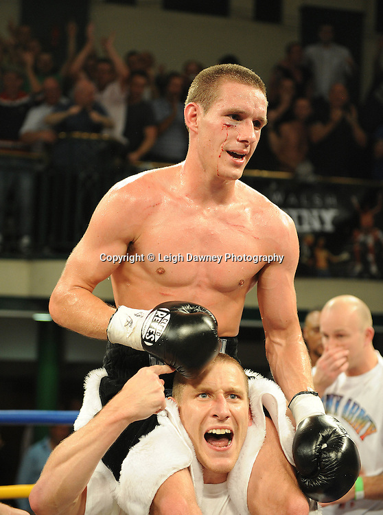 Liam Walsh (pictured with his brother) defeats Paul Appleby for The Commonwealth Super-Featherweight Championship at York Hall, Bethnal Green, London on Friday 30th September 2011. Box Nation.tv's debut live TV Channel 456 on Sky. Photo credit: © Leigh Dawney. Queensberry Promotions.