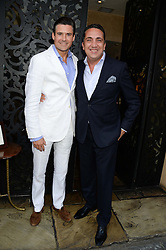 Left to right, EDWARD TAYLOR and ? at an evening of Dinner & Dancing at Daphne's, 112 Draycott Avenue, London SW3 on 24th July 2013.
