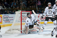 KELOWNA, CANADA - NOVEMBER 6:  Taz Burman #30 of the Red Deer Rebels defends the net against the Kelowna Rockets on NOVEMBER 6, 2013 at Prospera Place in Kelowna, British Columbia, Canada.   (Photo by Marissa Baecker/Shoot the Breeze)  ***  Local Caption  ***