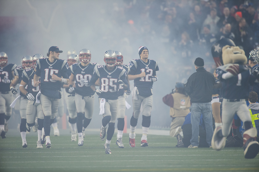 FOXBORO, MA - JANUARY 13:  Quarterback Tom Brady #12 of the New England Patriots and his teammates take the field before the AFC Divisional Playoff against the Houston Texans at Gillette Stadium on January 13, 2013 in Foxboro, Massachusetts.(Photo by Rob Tringali) *** Local Caption *** Tom Brady