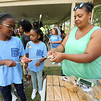 Hannah White, 10, a Girl Scout with Troup 20130, has a S'More made for her by volunteer Patricia Billups during the Girl Scouts Heart of the South National S'Mores Day celebration Friday night at Ballard Park in Tupelo.