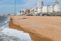 © Licensed to London News Pictures. 22/03/2020. Brighton, UK. Members of the public enjoy the sunny and mild weather to spend time on the beach in Brighton and Hove. Photo credit: Hugo Michiels/LNP