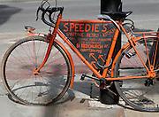Orange bike advertising retro shop Brick Lane