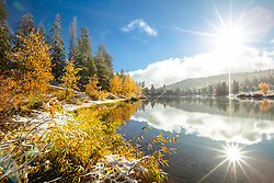 """Snowy Coldstream Pond 6"" - Photograph of a snowy shoreline and Fall colors at Coldstream Pond in Truckee, California."