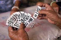 Detail of elderly Chinese Hakka lady holding playing cards